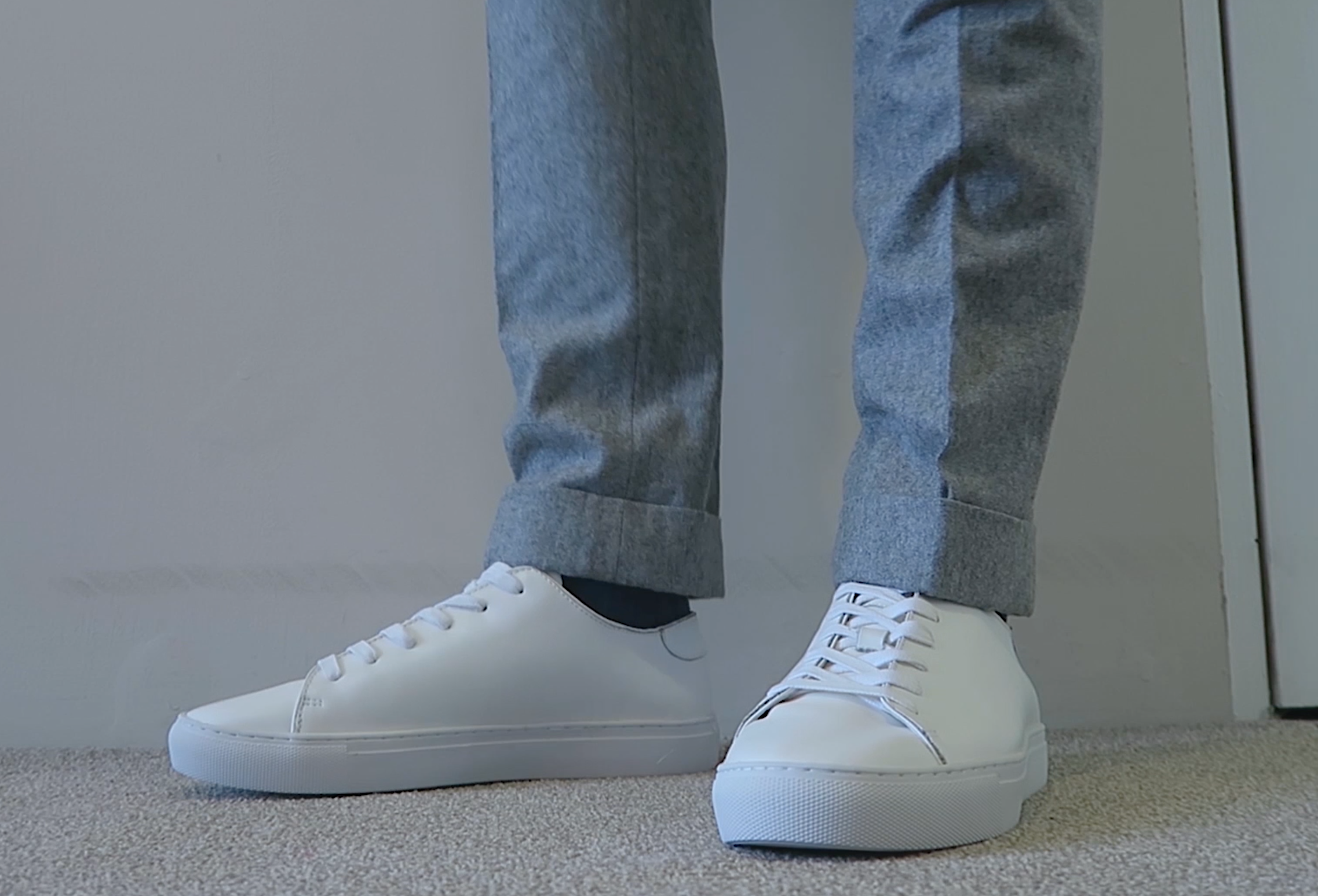 white sneakers wool trousers